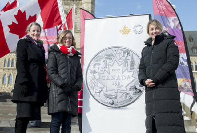 From left:  Royal Canadian Mint CEO Sandra Hanington, Minister of Democratic Institutions Karina Gould and Minister of Canadian Heritage Mélanie Joly unveil a new silver collector coin celebrating Canada 150 at the annual Flag Day ceremony on Parliament Hill in Ottawa, February 15. (CNW Group/Royal Canadian Mint)
