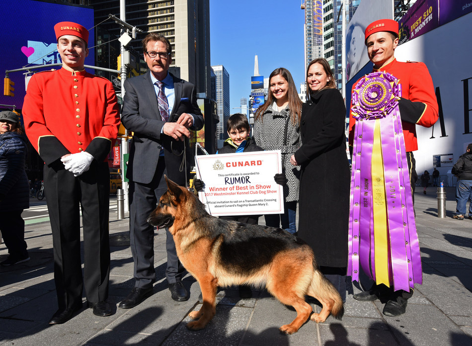 """Cunard presents Rumor, a German shepherd, winner of Westminster Kennel Club's """"Best in Show,"""" and her family, Kent Boyles, Daniel Oster, Maria Oster and Liz Oster, left to right, with a sailing on Queen Mary 2 during a photo op in New York's Times Square, Wednesday, Feb. 15, 2017. Cunard, a first-time sponsor of the Westminster show, is the only passenger liner to carry pets across the Atlantic on its signature Transatlantic Crossing. (Photo by Diane Bondareff/Invision for Cunard/AP Images)"""