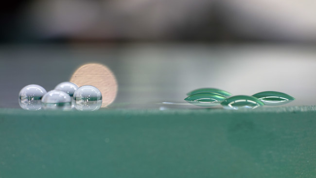 LEFT - Glass made highly hydrophobic with NANOMYTE(R) SR-100EC coating; RIGHT - Uncoated glass (low contact angle)