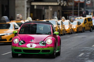 The toys make their way into the big apple for the North American International Toy Fair, taking place February 18-21, 2017. Moose Toys, makers of the global phenomenon Shopkins, will debut a new line of die-cast vehicles at Toy Fair, called Shopkins Cutie Cars. Pictured here, the life-size Motor Melon zipping alongside yellow cabs through New York City on February 15, 2017 to kick-off Toy Fair. Photo credit: Reuben Hernandez.
