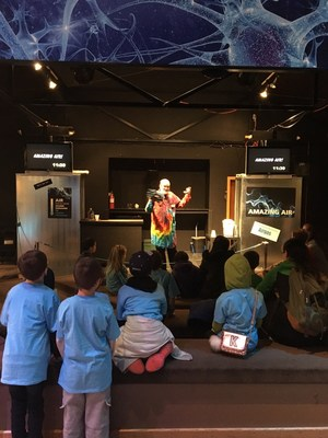 Students from Elmhurst Elementary engage with and actively listen to one of the many presentations throughout the day at the Pacific Science Center in Seattle. (PRNewsFoto/Inspirus Credit Union)