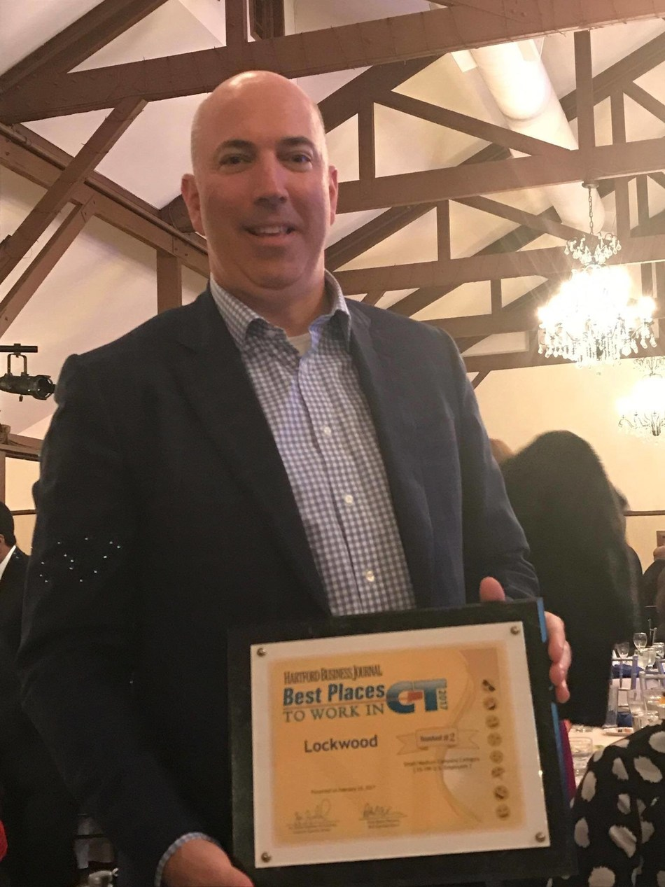 Matthew Schecter, President and CEO of The Lockwood Group, proudly accepts the Best Places to Work in Connecticut Award. Lockwood was named one of the top 2 Best Places to Work in the entire state of Connecticut.