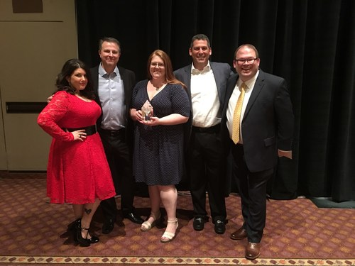 InComm's team receives the Vendor of the Year award from 7-Eleven. From left to right: Crystal Mellen, Payment Services Project Coordinator - 7-Eleven, Mark Hanners, Sr. Director, Accounts - InComm, Brandi Kowal, Sr. Category Advisor -InComm, Jerry Cutler, VP Sales - InComm and Brian Brooks, Product Manager - Payments at 7-Eleven.