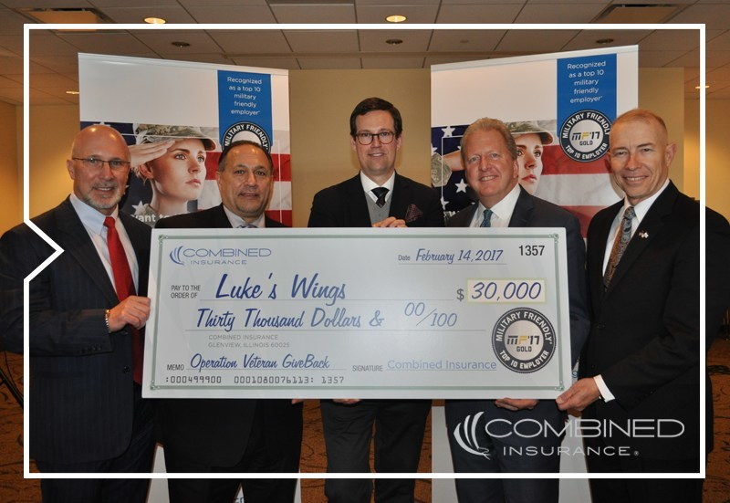 (L to R) Brad Bennett, President of Combined Insurance, Tony O'Dierno, Senior Vice President and Zone Manager of Combined's East Zone, Fletcher Gill, CEO and Co-Founder of Luke's Wings, Doug Abercrombie, Chief Agency Officer, and Bob Wiedower, Vice President, Sales Development and Military Programs at Combined Insurance.