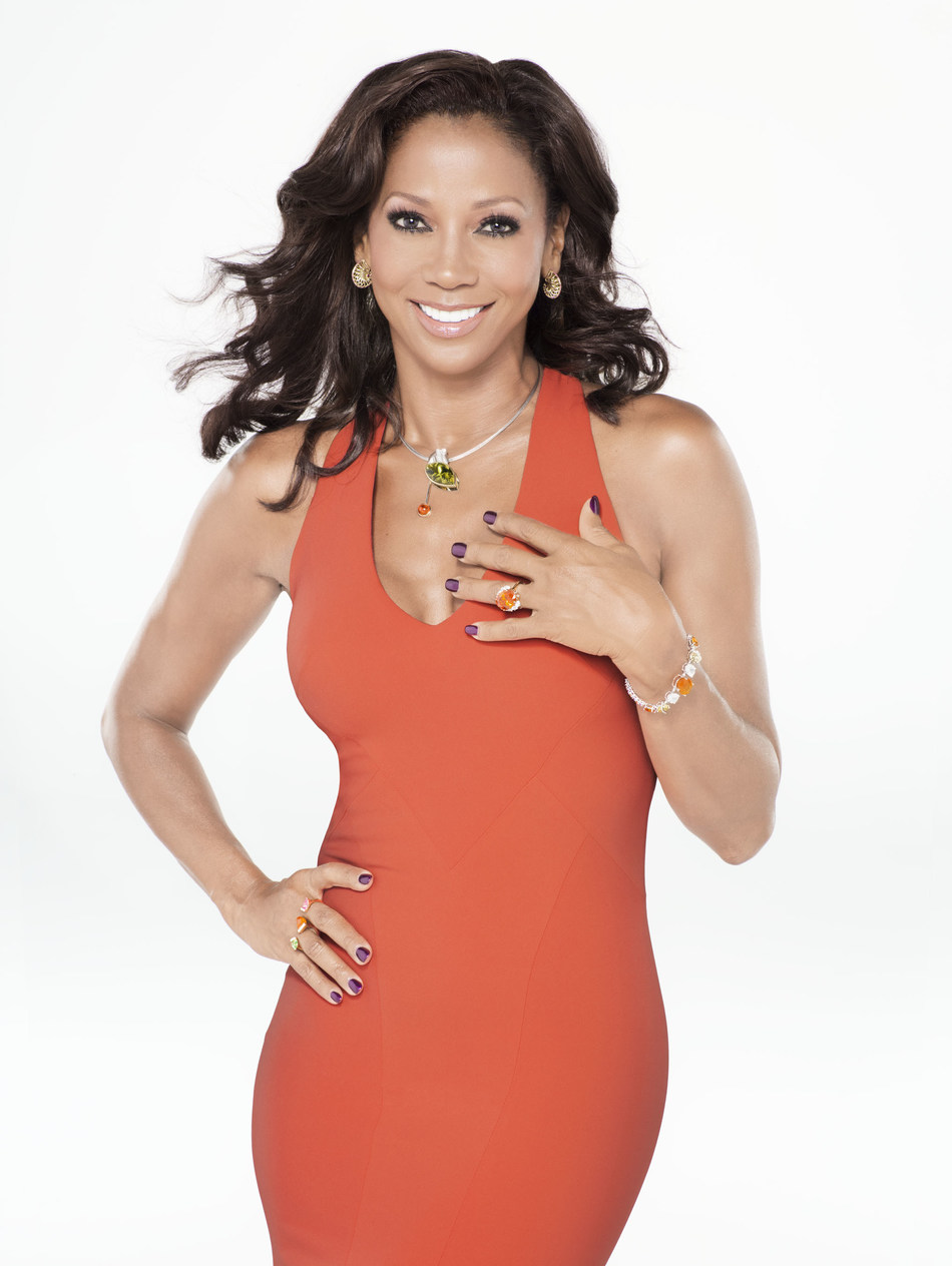 Featured in the photo: Holly Robinson Peete Necklace: Jewelsmith, Inc.; Ring #1: Wendy Brandes Jewelry; Ring #2: T. Foster & Co, Fine Jewelers; Bracelet: ARYA ESHA; Earrings: llyn strong fine art jewelry; Photographer: Andrew MacPherson; Stylist and Producer: Tod Hallman