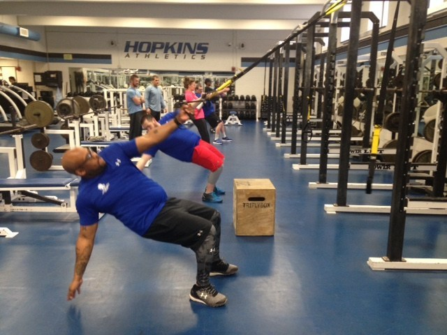 Warriors served by Wounded Warrior Project exercise during a workout at Johns Hopkins University,