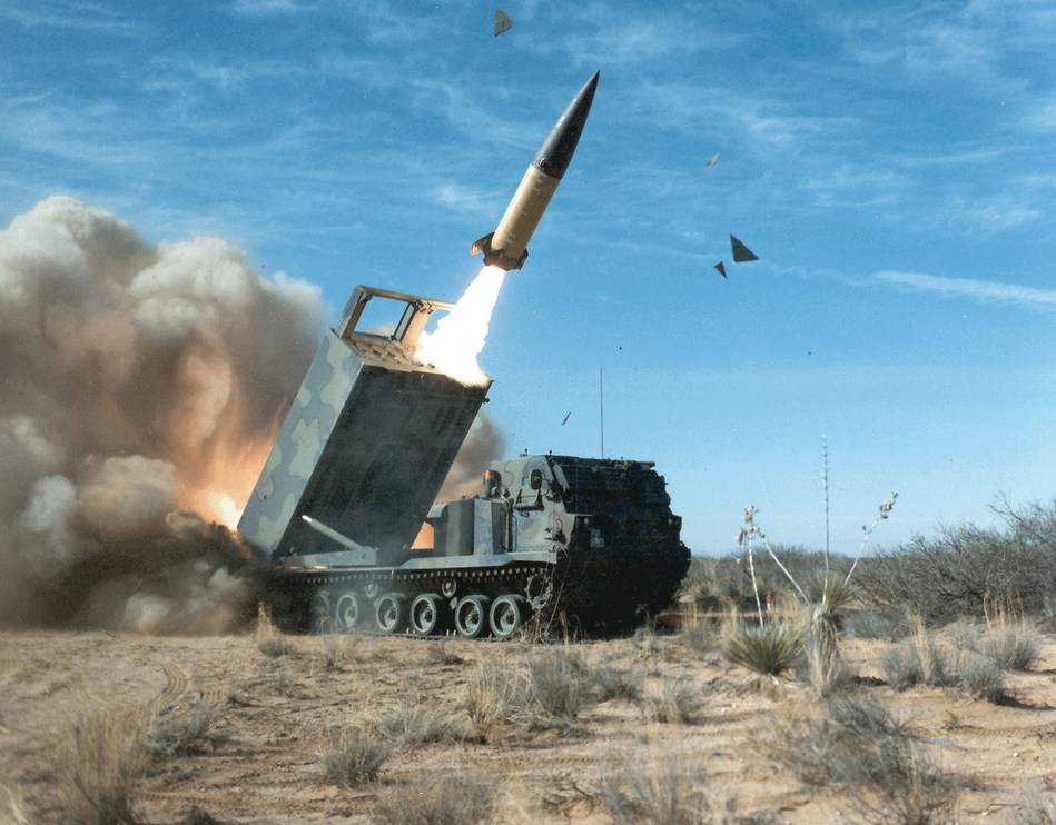 A TACMS long-range missile takes flight from a Lockheed Martin M270A1 launcher during a test.