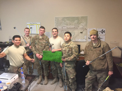 Soldiers with their golf equipment.