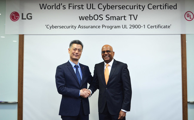 JH Hwang, senior vice president and head of R&D at the LG Electronics Home Entertainment Company (left), and Sajeev Jesudas, president of the UL consumer business, commemorate the LG webOS 3.5 Security Manager as the world's first smart TV platform certified by UL for effective cybersecurity capabilities.