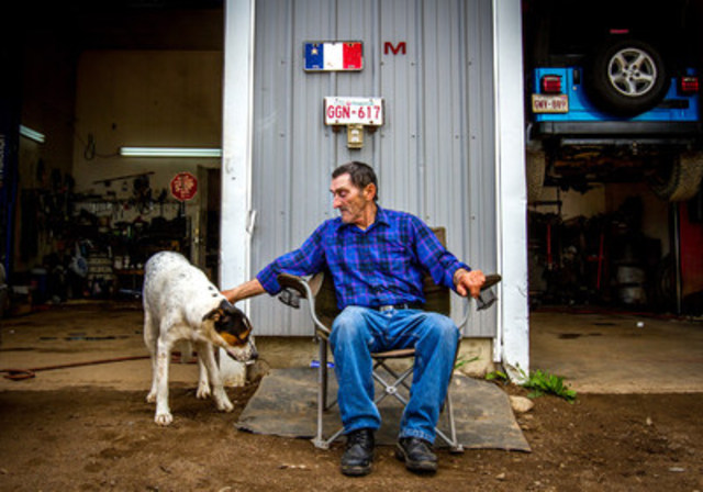 A photo of Marcel Richard in Rogersville, N.B. in front of his backyard mechanic shop was part of Chris Donovan's winning submission for the 2017 Tom Hanson Photojournalism Award. Photo: Chris Donovan. (CNW Group/Canadian Journalism Foundation)