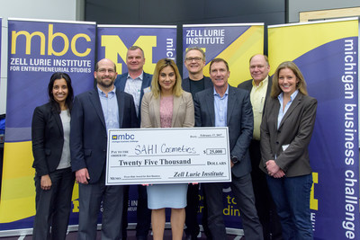 Shelly Sahi (MBA '16, center), founder of SAHI Cosmetics, is presented with the top prize for the Michigan Business Challenge by the Zell Lurie Institute. From left to right: Sarika Gupta, Josh Botkin, Charles Fry (Zengistics), Shelly Sahi, Jim Price, Stewart Thornhill, Jack Ahrens (TGap Ventures), Anne Perigo