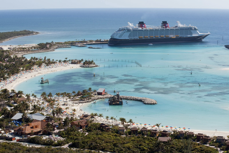 The Disney Dream docks at Castaway Cay, Disney's private island in the Bahamas, reserved exclusively for Disney Cruise Line guests. In a setting of crystal-clear turquoise waters, powdery white-sand beaches and lush landscapes, the 1,000-acre island offers one-of-a-kind areas and activities for every member of the family. (David Roark, photographer)