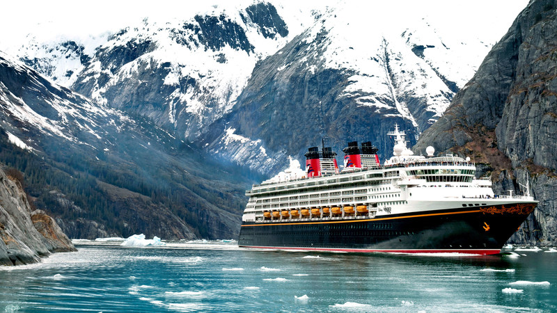 In 2018, Disney Cruise Line guests can set sail to Alaska on variety of five-, seven- and nine-night itineraries departing from Vancouver, Canada. Pictured here, the Disney Wonder sails through Alaska's Tracy Arm Fjord. (Kent Phillips, photographer)