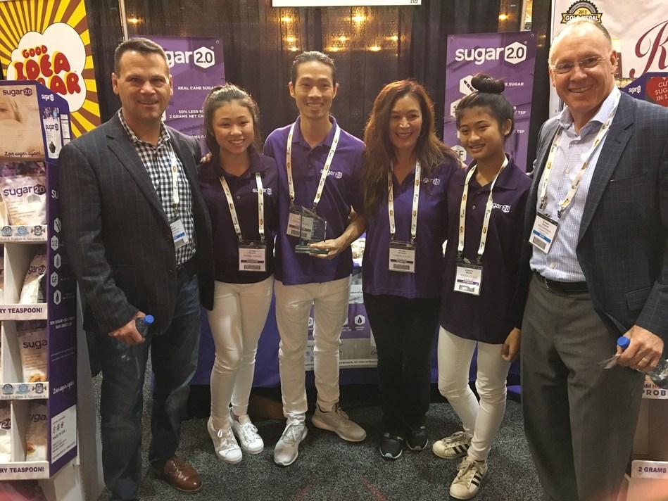 """Scott Weber and Brandon Barnholt of KeHE join Most Innovative """"Best of"""" winner Sugar 2.0 at KeHE's Summer Selling Show in New Orleans."""