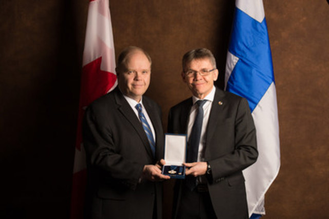 Greater Sudbury resident, Dr. Kevin McCormick is presented with the Knight, First Class, of the Order of the White Rose of Finland, by His Excellency Vesa Lehtonen, Ambassador of Finland to Canada. (CNW Group/Huntington University)