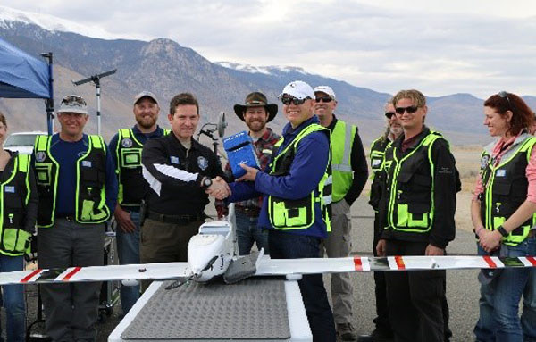 Drone America presents the long-distance package flown to the Nevada UAS Test Site Director, Dr. Chris Walach on February 15th, 2017.  Credit: Mark Barker, NIAS.