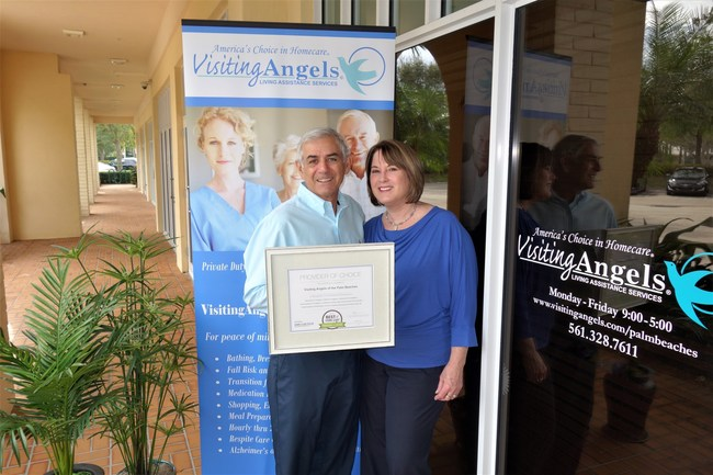 Irv Seldin and Colleen Haggerty, Co-Owners of Visiting Angels of the Palm Beaches, proudly display the 2017 Best of Home Care - Provider of Choice(R) Award.