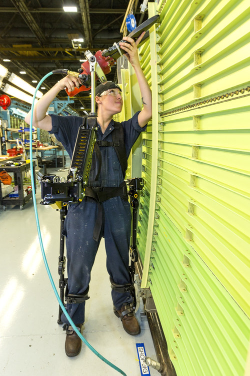 Tiffany Sharp, an aircraft structural mechanic in Marietta, Georgia, uses a Lockheed Martin FORTIS(R) exoskeleton to easily attach rivets to a C-130J Super Hercules wing assembly.