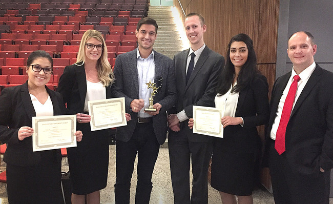 South Texas College of Law Houston students and alumni coaches Sarah Cutropia, Morgan Bird, Craig Priesmeyer, Daniel Mears, Delaram Falsafi, and Shawn Williamson celebrate the school's 124th national advocacy win at the Law & Science National Mock Trial Competition, hosted by the Sandra Day O'Connor College of Law at Arizona State University, in Phoenix, Ariz. over the weekend.