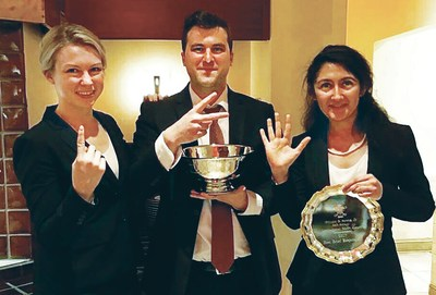 South Texas College of Law Houston students Stephanie Bryant, Randall Towns, and Niloufar Hafizi stand with their trophies after winning the school's 125th national advocacy title at the National Constitutional Law Moot Court Competition at the William & Mary Law School in Williamsburg, Va. over the weekend. No other law school in the country can claim half as many wins.