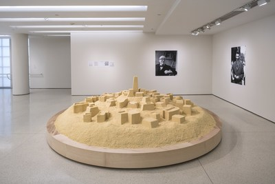 Kader Attia, Untitled (Ghardaïa), 2009. Couscous, two inkjet prints, and five photocopy prints, couscous diameter: 500 cm; inkjet prints: 180 x 100 cm and 150 x 100 cm; photocopy prints: 150 x 100 cm , Solomon R. Guggenheim Museum, New York, Guggenheim UBS MAP Purchase Fund, 2015. Installation view: But a Storm Is Blowing from Paradise: Contemporary Art of the Middle East and North Africa, Solomon R. Guggenheim Museum, New York, April 29-October 5, 2016. Photo: David Heald (PRNewsFoto/Solomon R. Guggenheim Foundation)