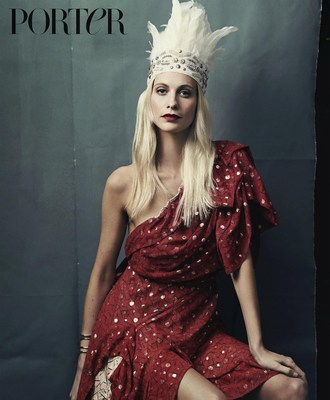 Poppy Delevingne wears dress by Andreas Kronthaler for Vivienne Westwood, headdress by Curious Fare and cuff by Jennifer Fisher, photographed by Bjorn Iooss for PORTER. All items can be purchased directly off the pages of PORTER magazine either by scanning the item with the NET-A-PORTER shopping app or by purchasing the PORTER digital edition at https://itunes.apple.com/gb/app/porter-magazine-uk/id803076371?mt=8 (PRNewsFoto/PORTER, powered by NET-A-PORTER)