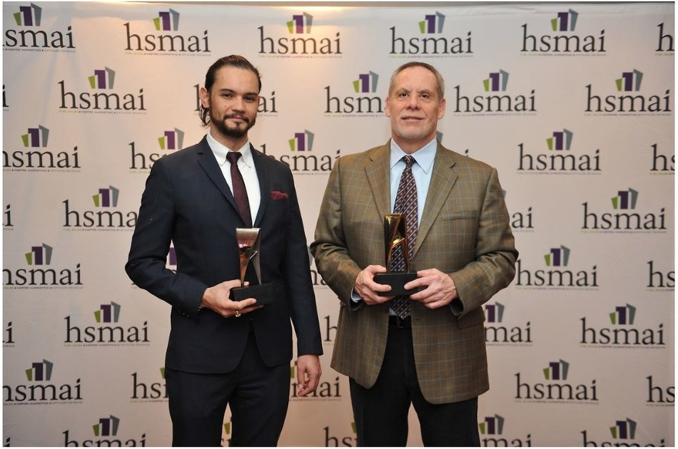 Daniel Durazo, Director of Communications at Allianz Worldwide Partners (right) and Justin Vallejo, Vice President at Finn Partners, accept awards at HSMAI Adrian Awards Dinner Reception and Gala in New York on February 21, 2017.