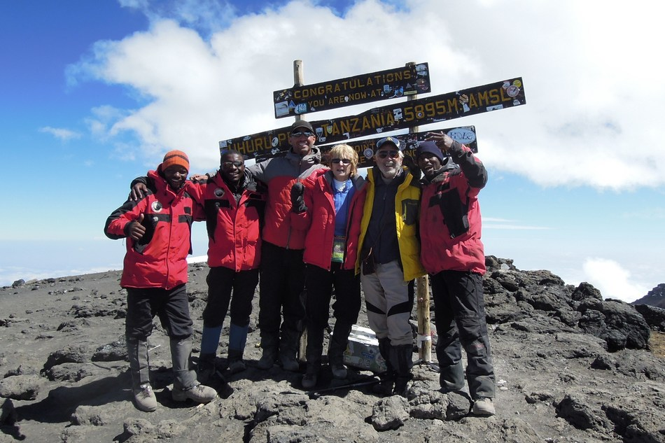 RETURNING TO THE SITE OF THE CLIMB:  Priscilla and Art Ulene celebrate the former TODAY Show Doctor's 75th birthday with their World Wide Trekking Guides at the 19,341' summit of Mt. Kilimanjaro in July, 2011.  The group returns on July 11, 2017, to celebrate his 81st birthday.