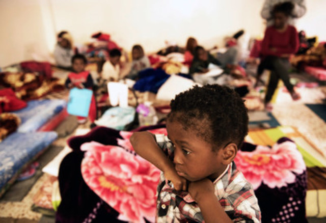 A child stands in a room where women and children sleep on old mattresses laid on the floor at a detention centre, in Libya. Sixty women, 20 children and 115 men were being held at the detention centre when UNICEF visited on January 29, 2017. Conditions at the centre are poor, with dozens of people crowded into small spaces. One child interviewed said they are only taken outside once every four days. © UNICEF/UN052793/Romenzi (CNW Group/UNICEF Canada)