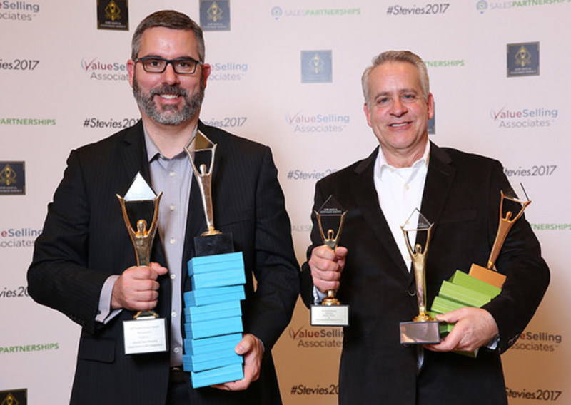 VIZIO's VP of Support Scott Patten and VP Support Operations RJ Riemer accepting 15 Stevie Awards for customer service excellence at the 11th annual event in Las Vegas, Nevada.