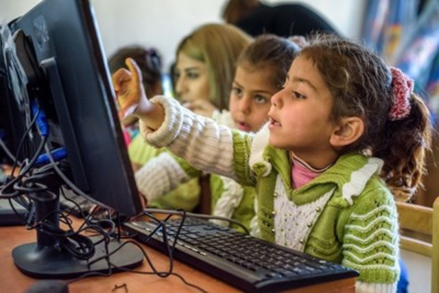 Computer training helps children become familiar with technology at World Vision's Child-Friendly Space for Syrian refugees in Lebanon. (CNW Group/World Vision Canada)