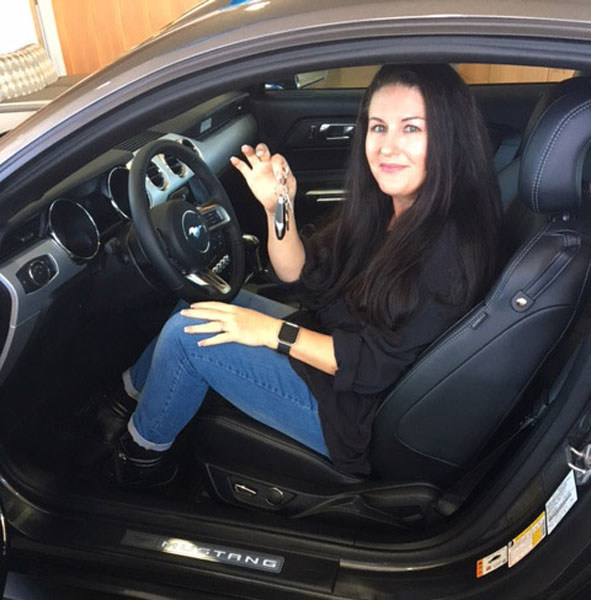 Robin Staudte, last year's winner of the Mustang 5.0 Fever Sweepstakes, picks up her 2017 Ford Mustang GT at Penske Ford in La Mesa, CA.