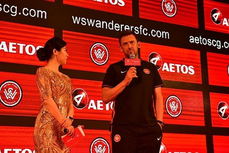 Head coach of A-League club Western Sydney Wanderers Tony Popovic on stage to talk about the partnership. (PRNewsFoto/AETOS Capital Group Ltd)