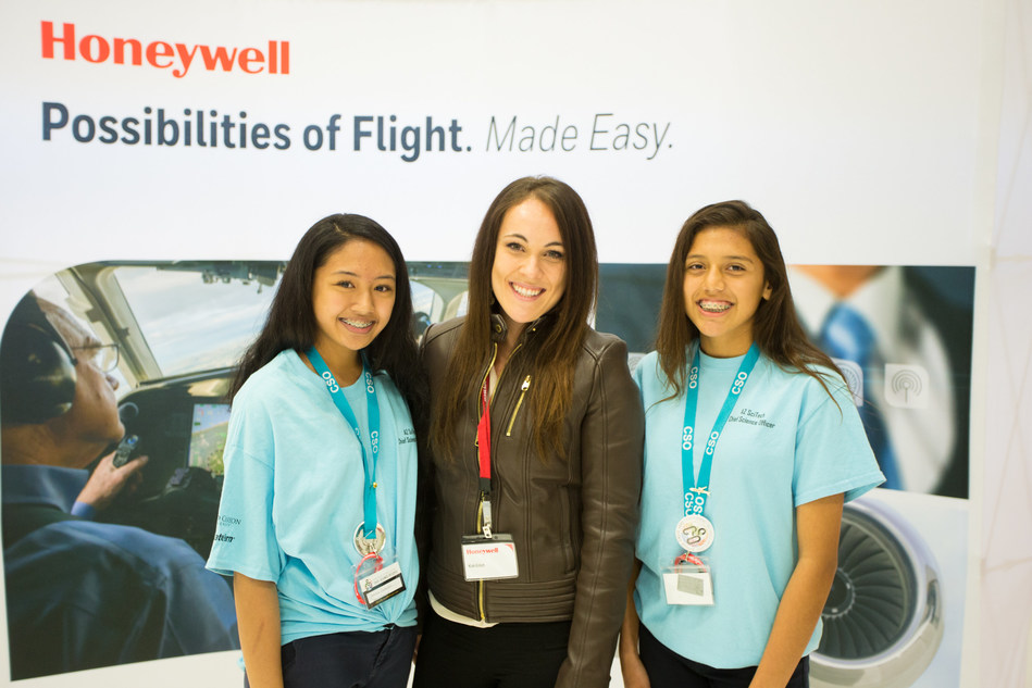 Kiah Erlich, Honeywell director of Flight Services, with CSO Jessica (L) and CSO Melany (R) from Sheely Farms Elementary School at a Honeywell Hometown Solutions event in Phoenix.