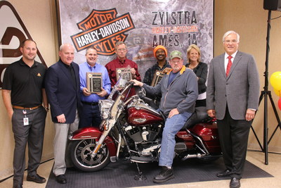 Art Clubb, Decker Truck Line, Inc.'s 2016 Grand Champion Professional Driver of the Year, on his brand new 2016 Harley Davidson, along with Decker's Executive Team and the other top professional driver finalists. Listed from left to right: Dale Decker, vice president; Todd Smith, chief operating officer; Jerry Schad, Owner/Operator Division; John Hodges, Flatbed Division; Sheldon McAfee, Midwest Reefer Division; Tammy O'Tool, vice president of administration; and Don Decker, president and CEO.