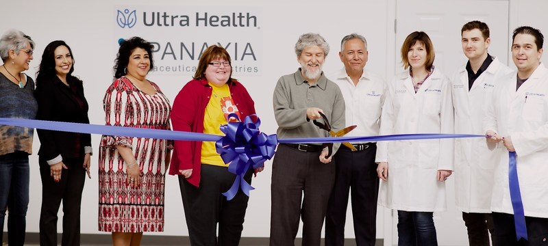 Mayor Torres of the Town of Bernalillo cuts the ribbon during the ceremony for the opening of the Ultra Health Panaxia lab on Tuesday, February 28, 2017 in Bernalillo, New Mexico.