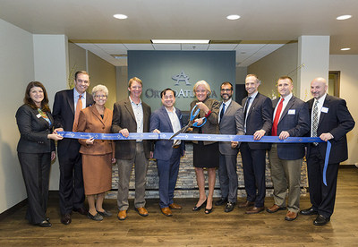 OrthoAtlanta Gwinnett Expansion Ribbon-Cutting Ceremony including (l to r) Gwinnett Chamber of Commerce, Sandy Richardson; Brian Morgan, MD; City of Lawrenceville, Georgia, Mayor, Judy Jordan Johnson; David Stokes, MD; Tuan Bui, MD; Intrahealth Group CEO Patty Brewster; Snehal Dalal, MD; Douglas Kasow, MD; Jeffrey Smith, MD; and William Lichtenfeld, MD.