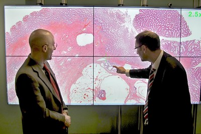 Darren Treanor, Consultant Pathologist and lead of the Leeds Digital Pathology Group, shows pathological features of a digital image to Jerome Clavel, Vice President and General Manager of Leica Biosystems Pathology Imaging Business (PRNewsFoto/Leica Biosystems)