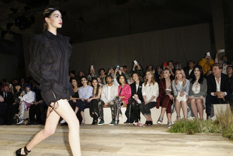 Gigi Hadid walks the runway at the H&M Studio show in Paris.