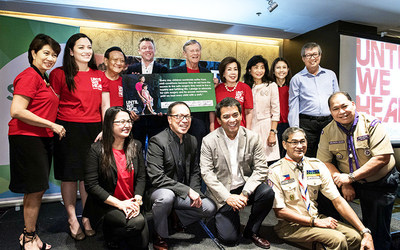 Operation Smile Co-Founder and CEO Dr. Bill Magee and members of the Philippines Board of Directors accept UNTIL WE HEAL pledges from partner representatives including the Office of the Vice President, Watsons, SMART Technologies, Boy Scouts of the Philippines and Hope Foundation.