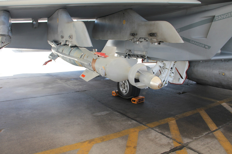 A Lockheed Martin Paragon laser-guided bomb is shown mounted on an F/A-18 Super Hornet weapon pylon.