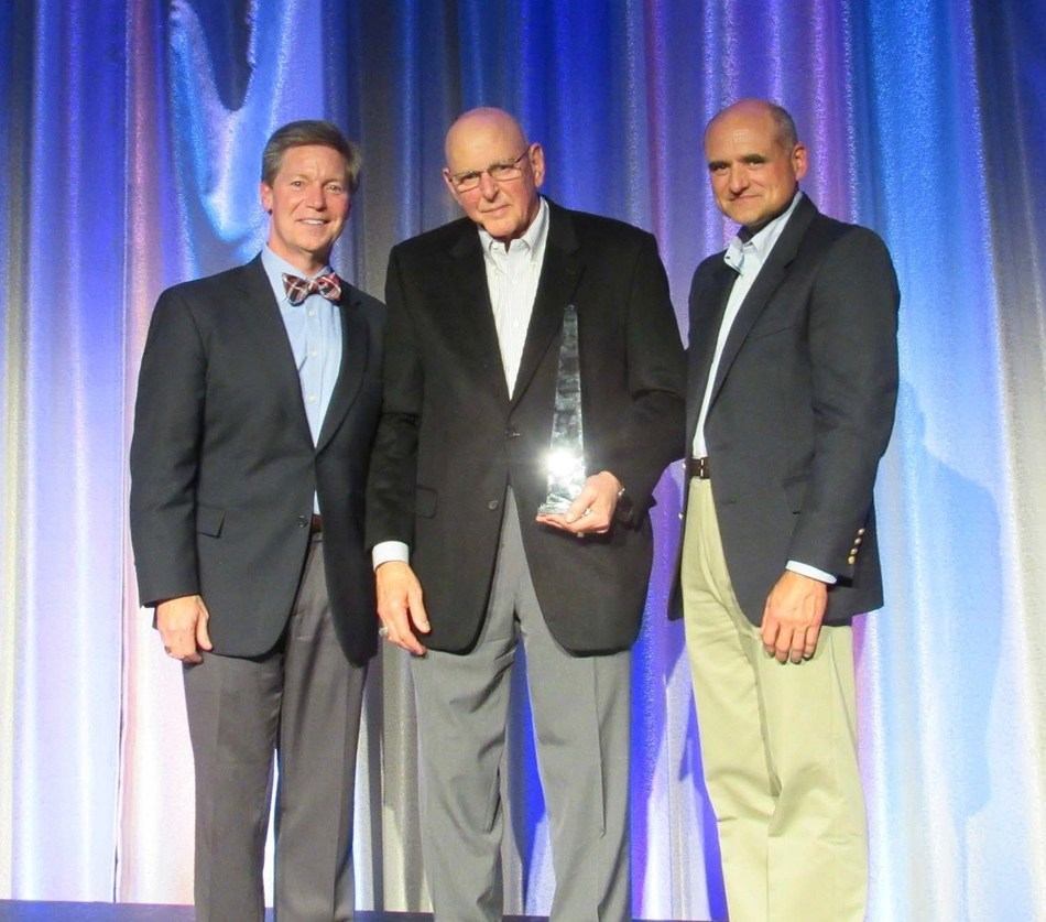 Perkins & Marie Callender's President & CEO, Jeff Warne (far left) and Jim Frank, Chief Operating Officer, Perkins & Marie Callender's (far right), recognized Larry Walker of L&E Management (center), as Perkins 2016 Franchisee of the Year at the company's recent Franchise Conference.