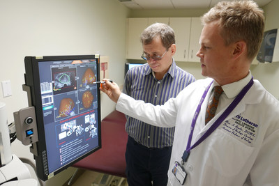 Marc Bjurlin, DO, (right) director of urologic oncology at NYU Lutheran Medical Center, reviews with patient Mikhail Kurbesov images of his MRI-ultrasound fusion targeted biopsy using the Artemis.