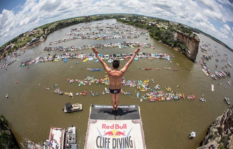 Jonathan Paredes of Mexico before he dives from the 27.5 meter platform on Devil's Island during the first stop of the Red Bull Cliff Diving World Series, Possum Kingdom Lake, Texas, USA on June 4, 2016. (Romina Amato/Red Bull Content Pool)