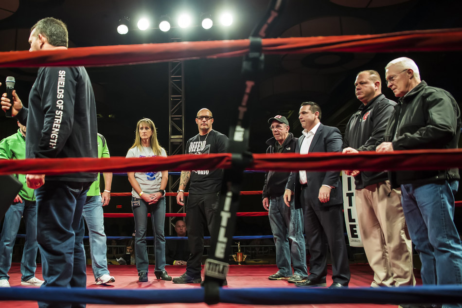 From center ring, Retired Army Col. David Dodd presented Thin Blue Line Shields of Strength to Jason Pappas, head of the Columbus Police union, and Dave Montgomery, head of the Columbus firefighters union, at The Arnold Classic Guns & Hoses 2017 title boxing match Thursday, March 2 at the Hollywood Casino in Columbus. (Photo by Misty Rayburn)