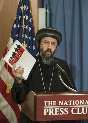 Bishop Angaelos of the Coptic Orthodox Church in the United Kingdom holds a copy of the report prepared by the Knights of Columbus and In Defense of Christians at a press conference in March 2016. A week later, the U.S. State Department declared that ISIS's crimes against Christians and other religious minorities in the Middle East were genocide. (Photo credit: Knights of Columbus)