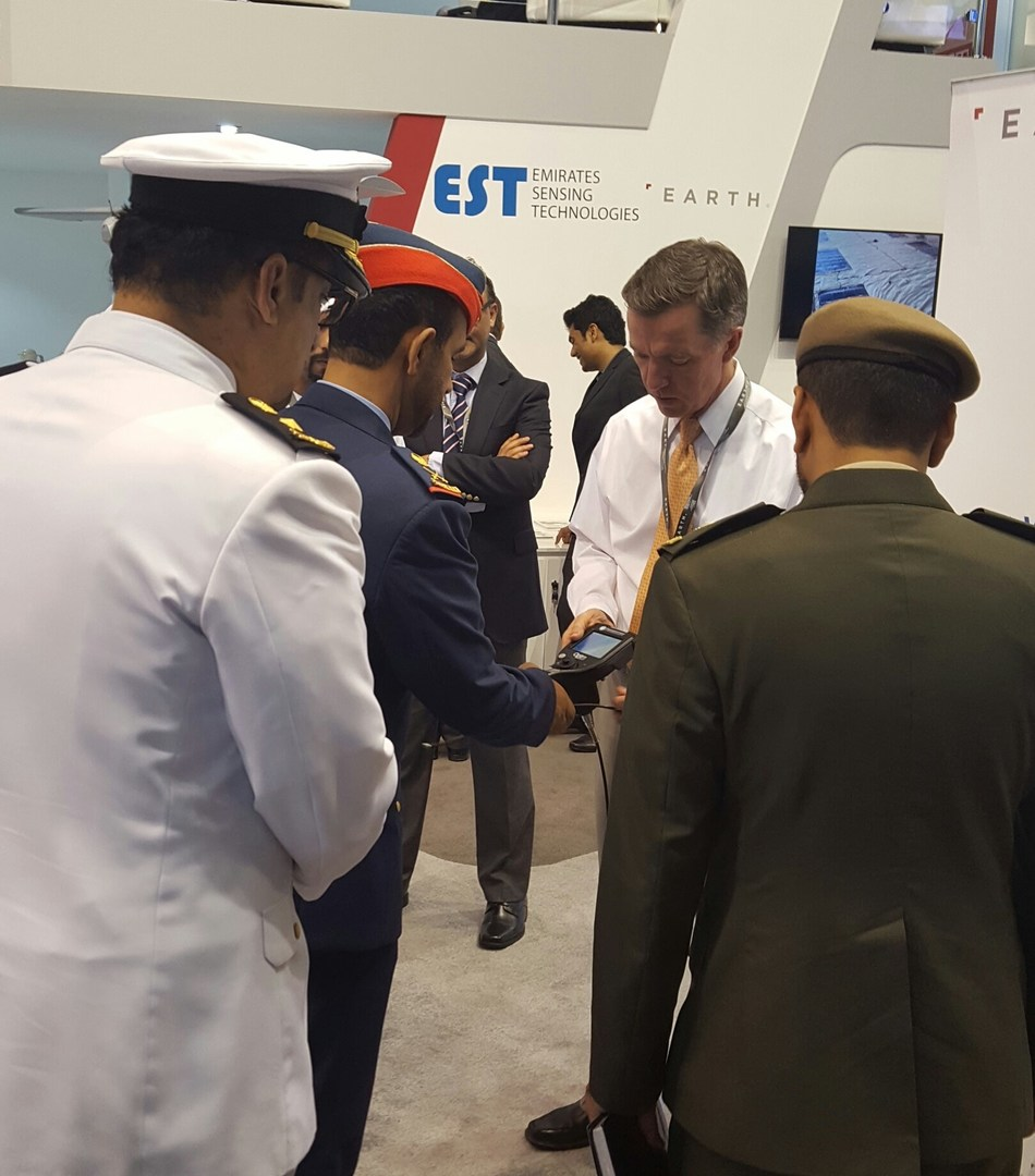 Paul Joyce, President of Optim LLC, demonstrates the ease of use of the FreedomView Videoscope to Deputy Chief of Staff for the UAE Armed Forces Staff Major General Eisa Saif Al Mazrouei and other UAE military leaders.