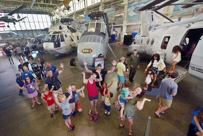 Visitors lined up outside the CH-46 Sea Knight, Hangar 79.