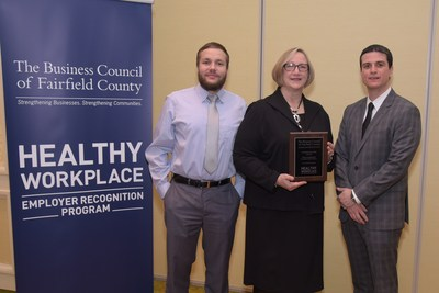 Barbara Valus, Director of Human Resources, Cartus,  accepts a Healthy Workplace Award from the Business Council of Fairfield County