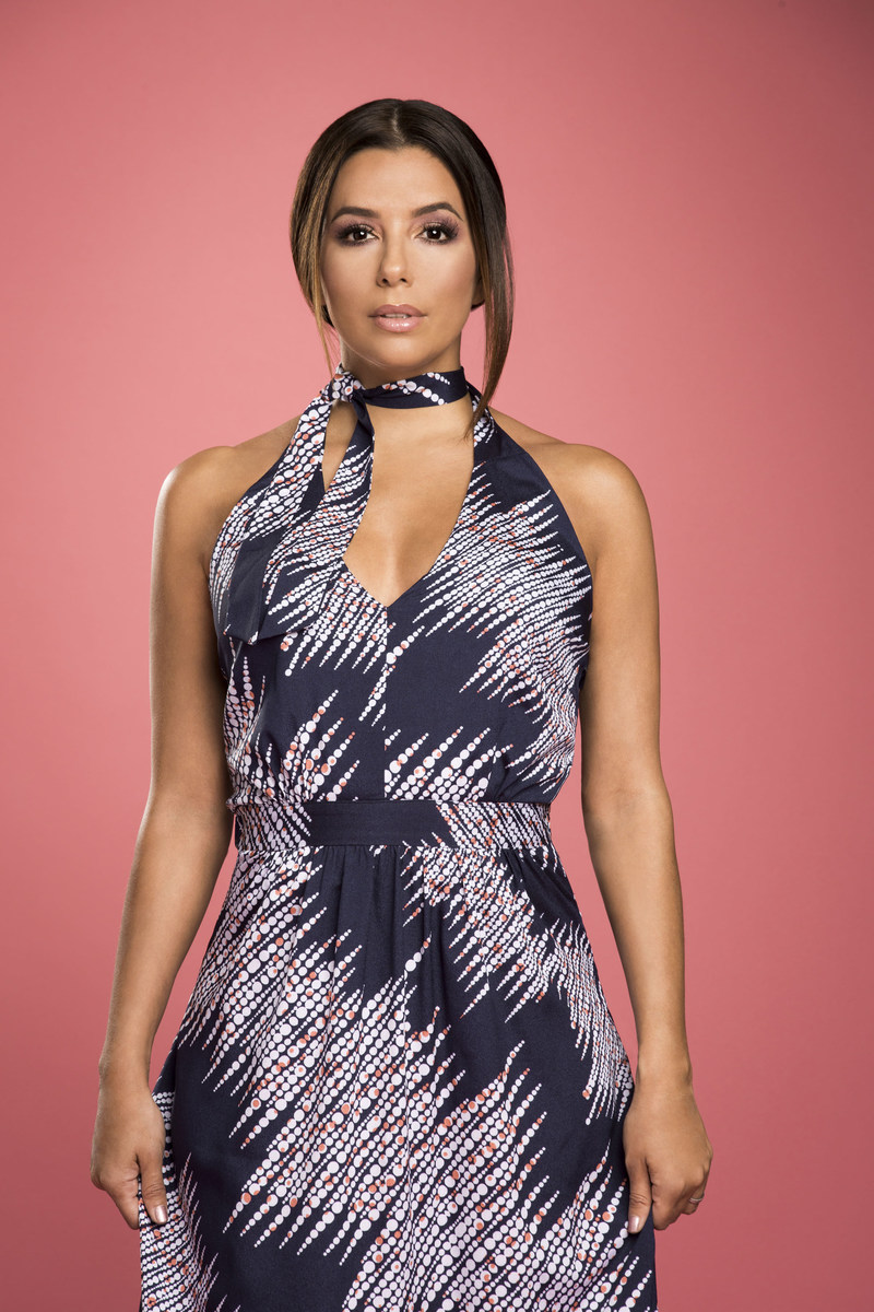 Eva Longoria is wearing the Malibu Halter Dress from her Spring 2017 collection available at www.evalongoria.com.
